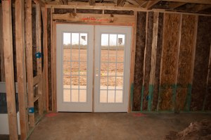 Double doors in the master bedroom to the patio in the back of the house.